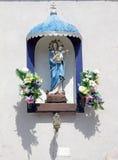 Un bordo della strada Madonna e bambino Immagini Stock