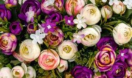 Un bouquet des fleurs artificielles Photos stock