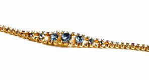 Un bracelet avec les pierres colorées Photo libre de droits