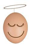 Un buon uovo - con il guidacarta - isolato su bianco immagini stock