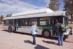 Un bus di spola al centro dell'ospite del grande canyon Fotografia Stock Libera da Diritti