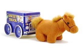 Un caballo del juguete con un carro Foto de archivo libre de regalías