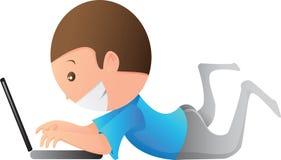 Un cabrito juega la computadora portátil Fotos de archivo