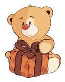 Un cachorro de oso relleno del juguete y una historieta de la caja Imágenes de archivo libres de regalías