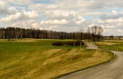 Un camino al campo del golf Imágenes de archivo libres de regalías