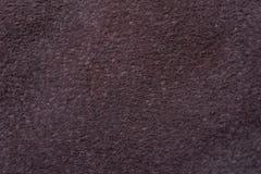Un campione del panno di cuoio scuro per cucire Fotografie Stock