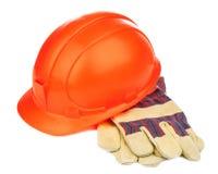 Un cappello della costruzione ed i guanti resistenti Fotografie Stock Libere da Diritti