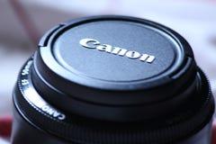 Un capuchon d'objectif de canon photo stock
