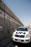 UN Car and Israeli Separation Barrier Royalty Free Stock Image