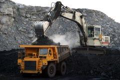 Un carro de mina amarillo grande Fotografía de archivo libre de regalías