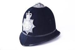 Un casco britannico dell'ufficiale di polizia Fotografia Stock