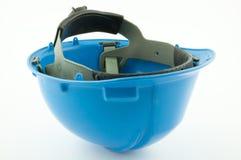 Un casque de sécurité bleu à l'envers photographie stock libre de droits