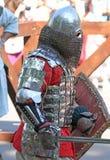 Un cavaliere medievale durante la battaglia Fotografia Stock