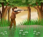 Un cazador dentro de la selva Imagenes de archivo