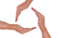 Un cerchio di tre mani Fotografie Stock