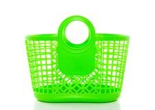 Un cestino di acquisto di plastica verde Fotografia Stock