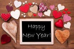 Un Chalkbord, muchos corazones rojos, Feliz Año Nuevo Fotos de archivo