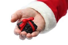 un charbon sur la main du père noël Photographie stock libre de droits
