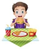 Un cibo del ragazzo Fotografia Stock Libera da Diritti