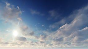 Un cielo azul claro con las nubes blancas Imagenes de archivo