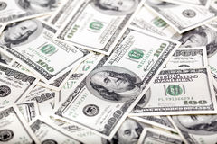 Cientos fondos de los billetes de dólar - lío Foto de archivo libre de regalías