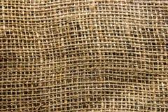 Un cierre encima de la foto del fondo/de la textura de la tela de la arpillera foto de archivo libre de regalías
