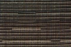 Un cierre para arriba de la textura material sintética tejida; colores naturales beige y marrones, imagen de fondo fotos de archivo