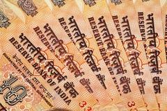 Un cierre para arriba del indio billetes de banco de 10 rupias Fotos de archivo libres de regalías
