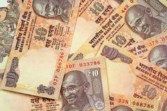 Un cierre para arriba del indio billetes de banco de 10 rupias Imagen de archivo libre de regalías