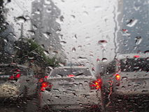 Un-clear vision through wind shield. Intraffic jammed during thunder shower rain Royalty Free Stock Photos