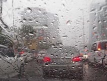Un-clear vision through wind shield. Intraffic jammed during thunder shower rain Stock Image