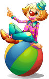 Un clown s'asseyant sur une boule Images libres de droits