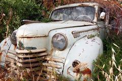 Un coche abandonado viejo Fotografía de archivo libre de regalías