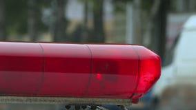Un coche policía está destellando almacen de metraje de vídeo