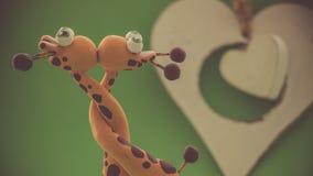 Un coeur blanc pour deux girafes Image stock