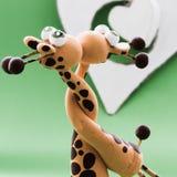 Un coeur blanc pour deux girafes Photos libres de droits