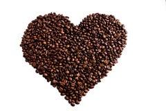 Un coeur d'amour fait de grains de café rôtis Image stock