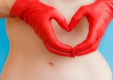 Un coeur de cuir rouge Image stock