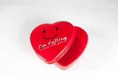 Un coeur en forme de boîte vide rouge, pour Noël, anniversaire, cadeau, holi Photographie stock