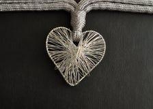 Un coeur fabriqué à partir de l'argent Photographie stock libre de droits