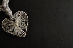 Un coeur fabriqué à partir de l'argent Images stock