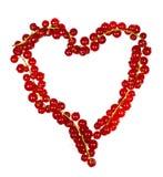 Un coeur fait de groseilles rouges Photo stock