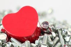Un coeur pour des vis Photos stock