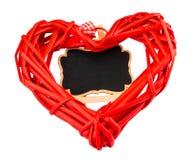 Un coeur rouge et un tableau noir sur le fond blanc L'espace pour le te Images stock