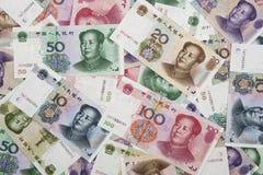 Un colage de los billetes de banco chinos de RMB Foto de archivo libre de regalías