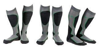 Un collage de trois paires de chaussettes grises de ski Image libre de droits