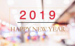 Un concetto di 2019 nuovi anni: Buon anno 2019 sul fondo astratto del bokeh della sfuocatura fotografia stock
