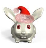 Un conejo del trasero en sombrero rojo en el fondo blanco Fotos de archivo libres de regalías