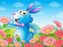 Un coniglio con i fiori nel giardino illustrazione di stock