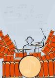 Un conjunto de tambores con el batería Imagen de archivo
